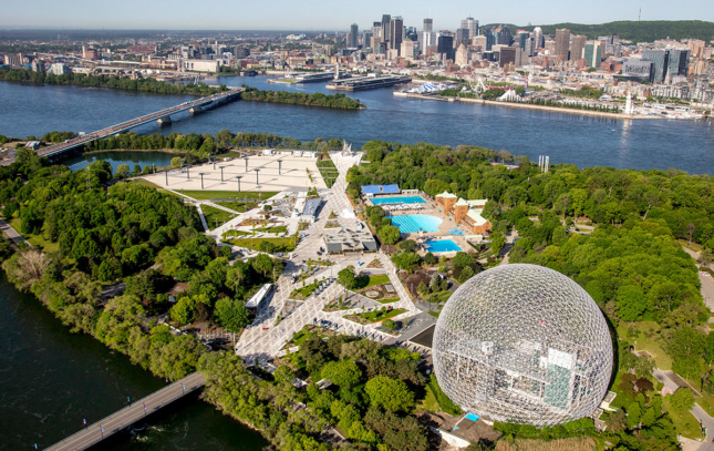 An aerial photograph shows Montreal's Parc Jean-Drapeau with it's large geodesic dome and green landscape.