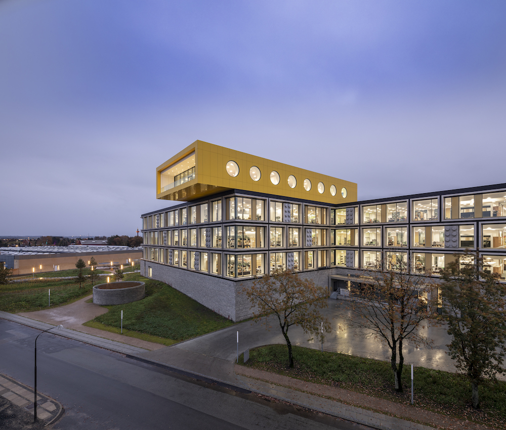 Photo of a cantilevering yellow block building