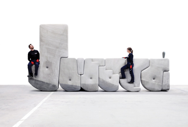 two people on top of concrete stones