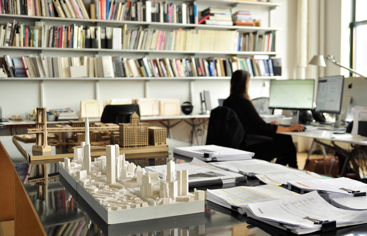 Image of architecture office with models, books, and paperwork at the Alloy office
