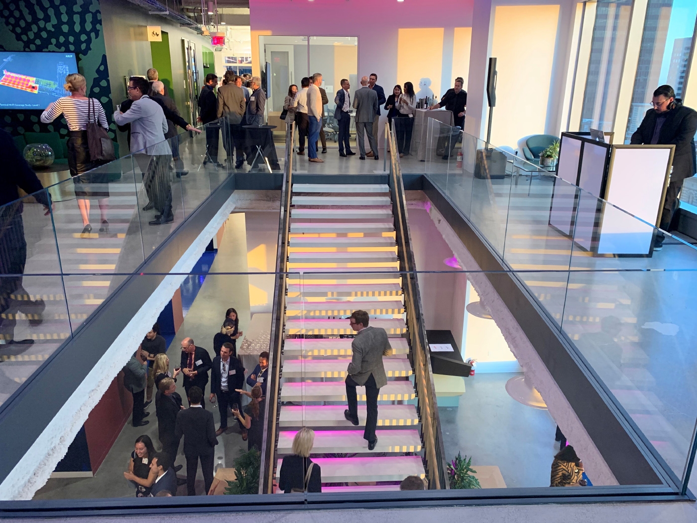 People ascending a staircase in the Arup office