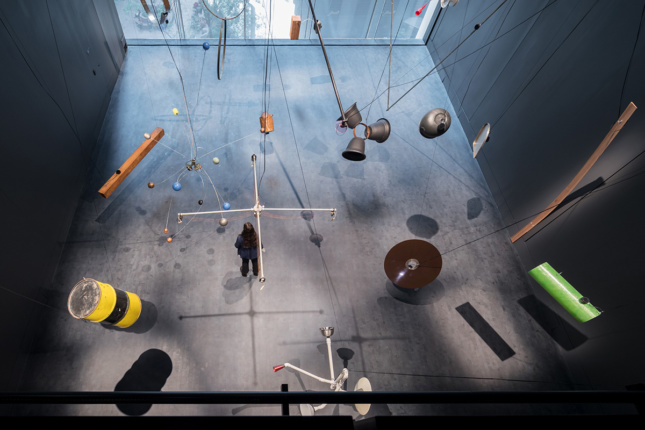 Aerial image looking down at black box room with large-scale window, sound work installation