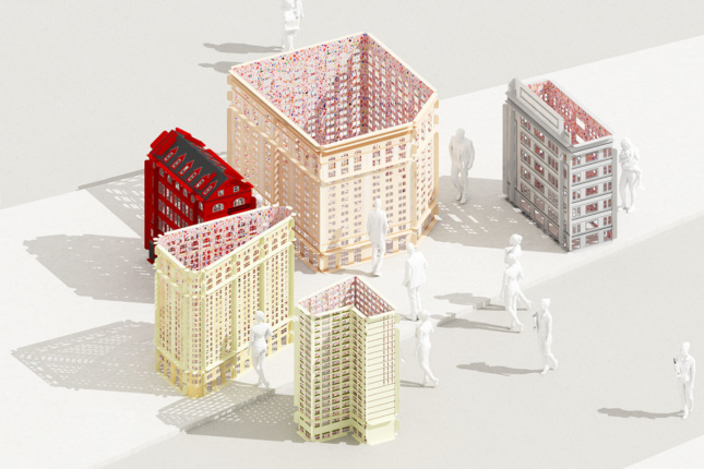 architectural models of new york's flatiron district sit on a table