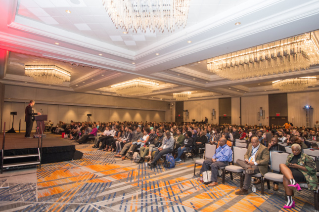 Interior of a ballroom filled with people for a NOMA keynote
