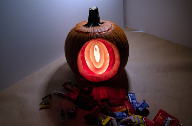 A tunnel carved into an illuminated pumpkin