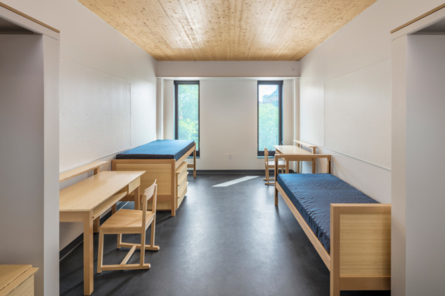 Interior of a dorm room at RISD with a timber ceiling