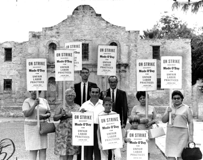 Photo of people picketing in front of the Alamo