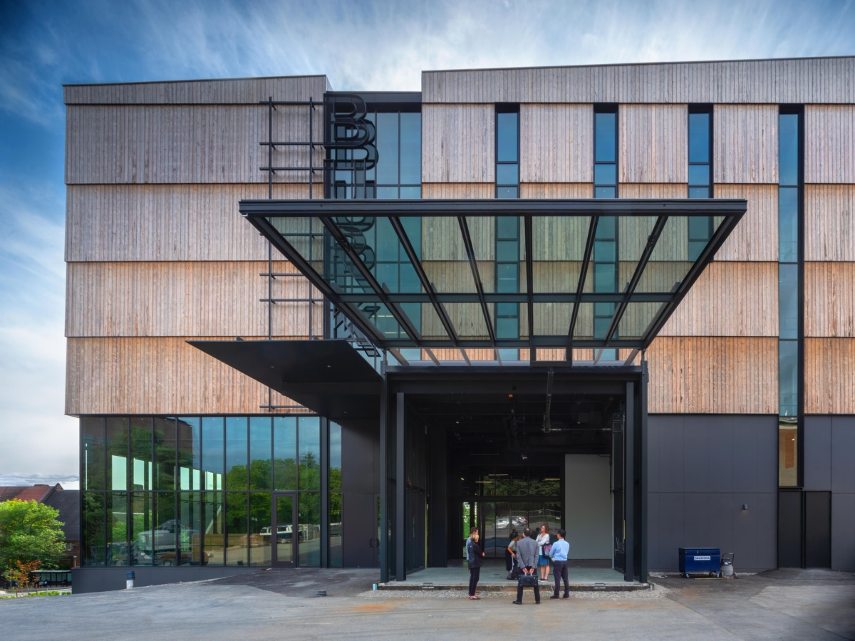 Exterior image of wood-clad museum with large glass overhang