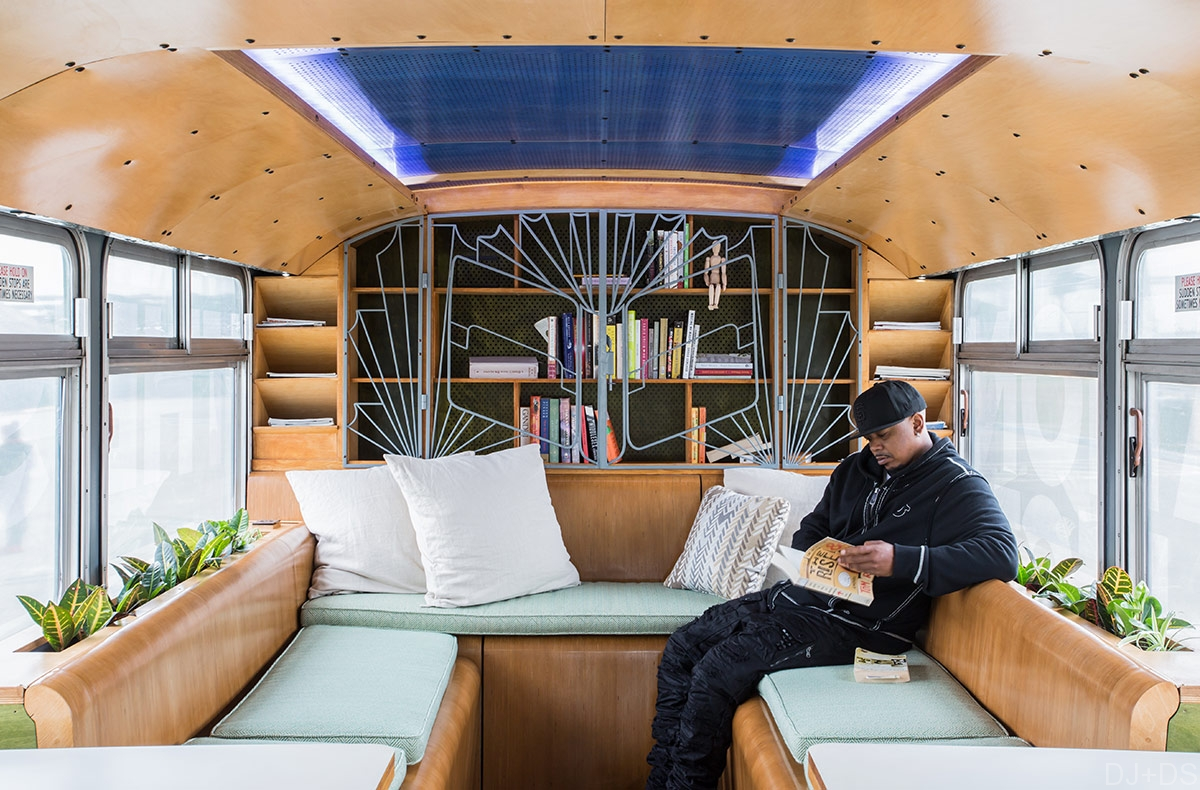 Interior of a plywood-clad mobile classroom from Designing Justice