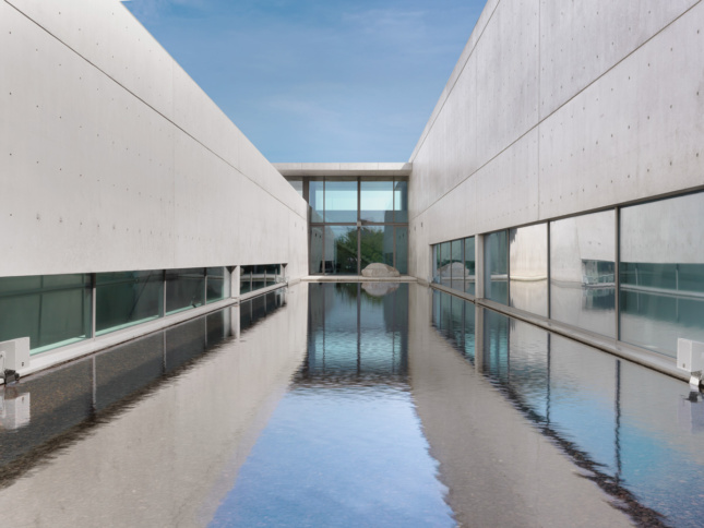 Image of courtyard within concrete art museum and reflecting pool