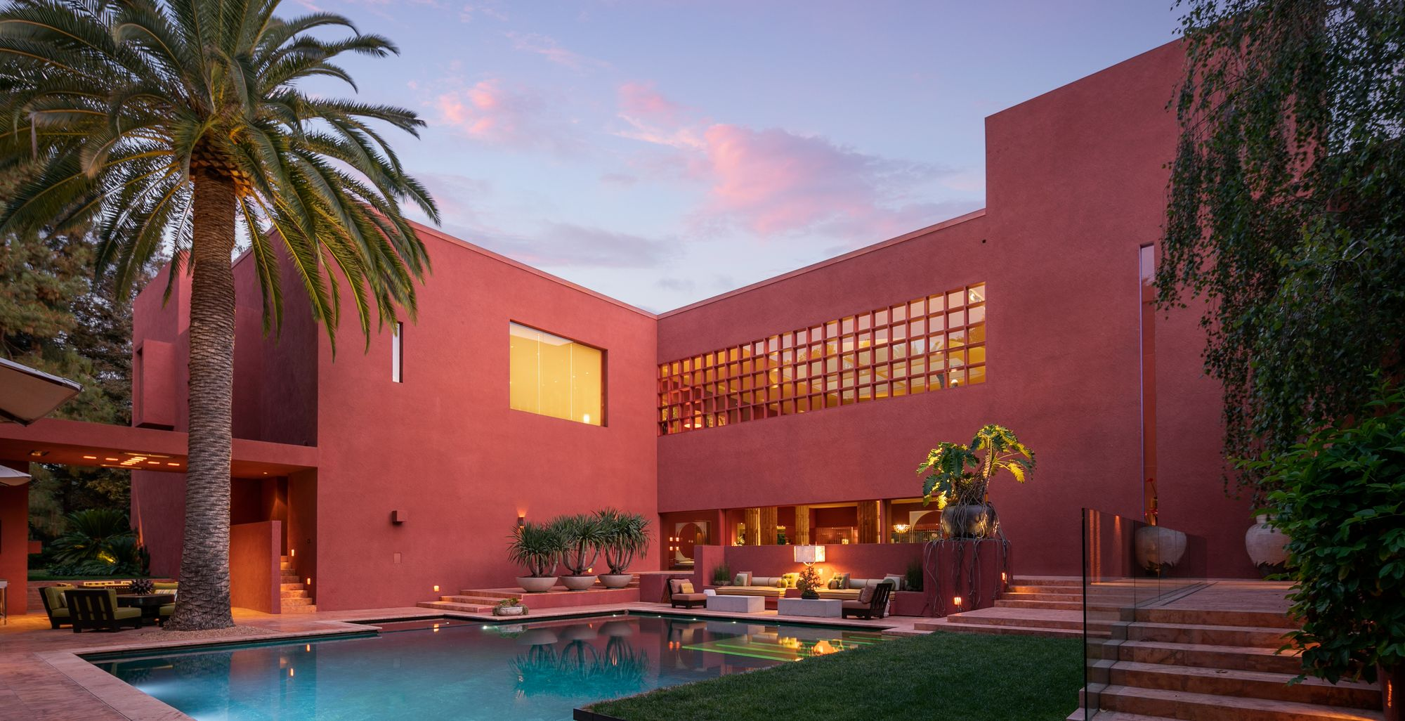 Photo of a pool surrounded by red walls in a Ricardo Legorreta home