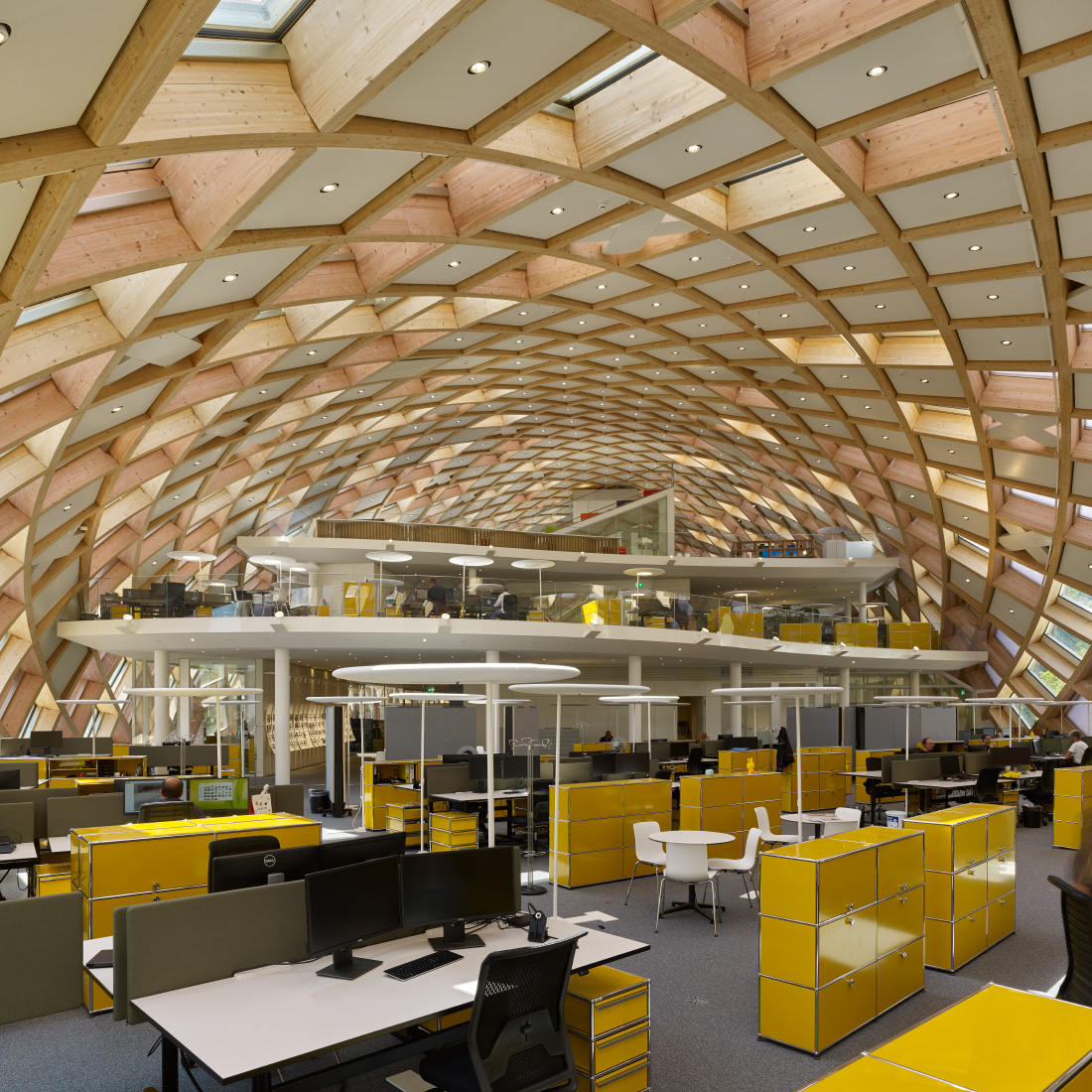Interior of the Swatch office, with a timber coffered ceiling