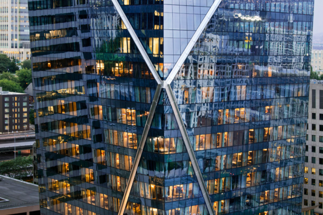 An intersecting steel X on the facade of The Mark tower