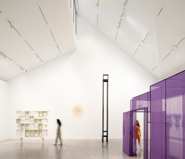 Installation photo of a triple-height gallery space