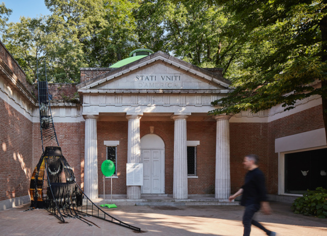 A man walking by the U.S.'s 2018 Venice Architecture Biennale pavilion in 2018