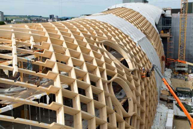 Construction photo of a gridded wooden structure
