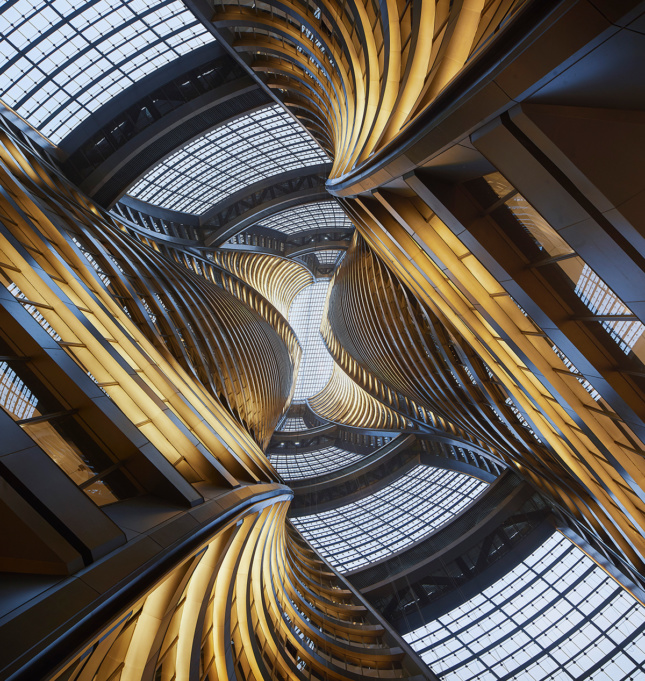 Photo looking up at spiraling office tower interior in the Leeza SOHO