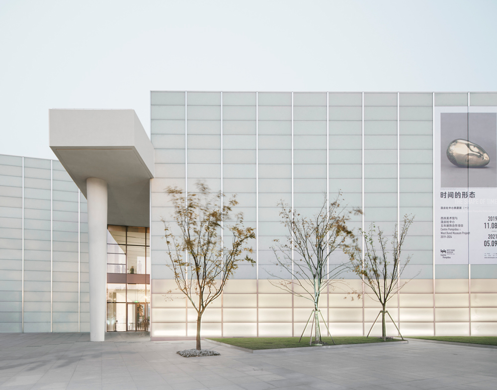 Photo of the Centre Pompidou offshoot in China, a white box lit from within