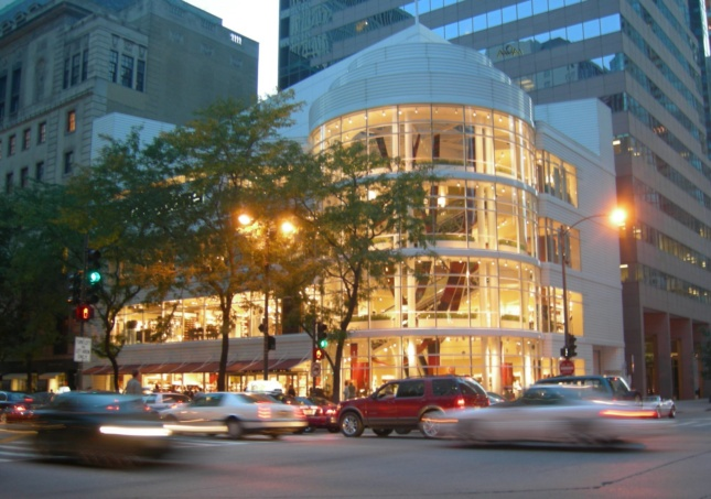 Exterior photo of a spiraling Crate and Barrel store clad in glass