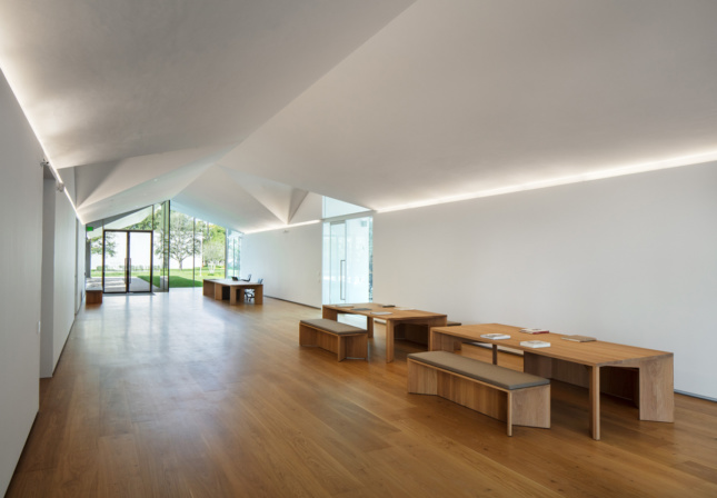 A timber floored hall with benches