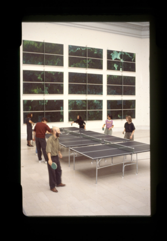 Black-and-white photo of people playing ping-pong