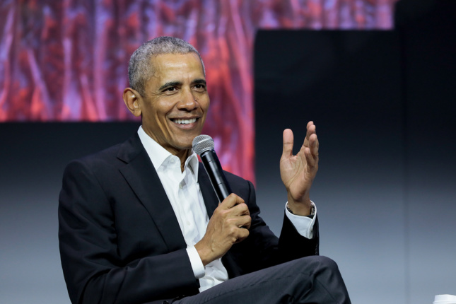 President obama sits holding a microphone giving a keynote talk at Greenbuild 2019