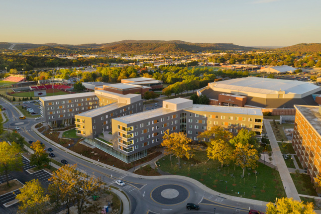 Aerial view of the University of Arkansas campus residential hall at sunset