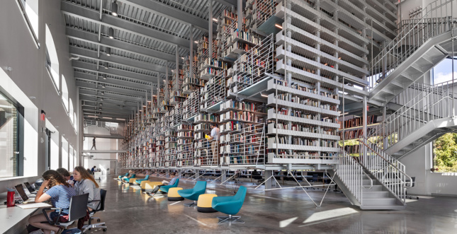 Interior daylight shot of steel library stacks and seating