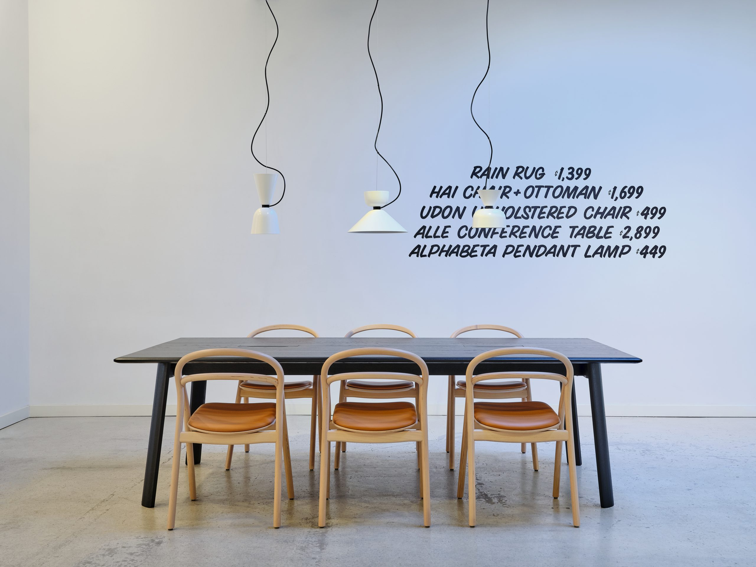 Installation view of lights over a table at Hem
