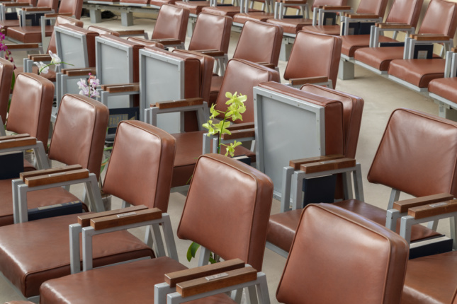 A flower pot in between rows of seats