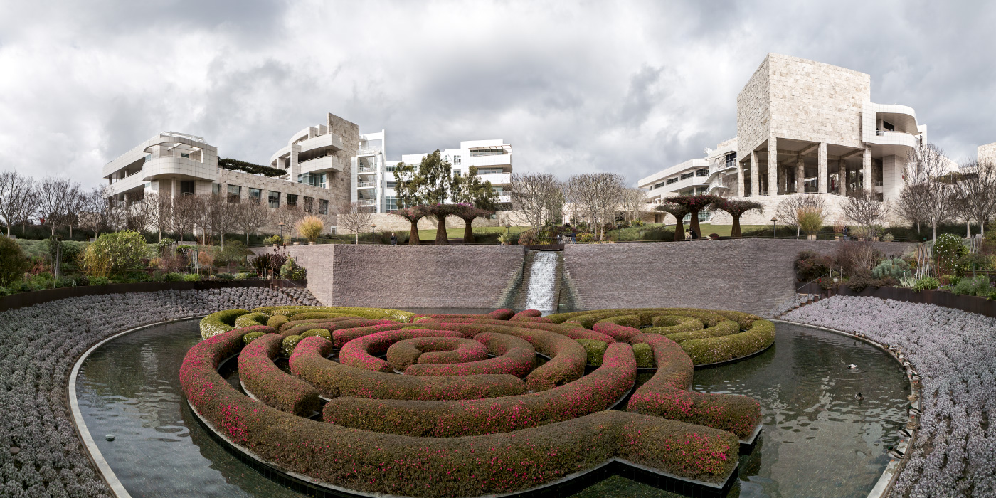 A wide panoramic shot of several imposing white buildings that comprise the Getty Center