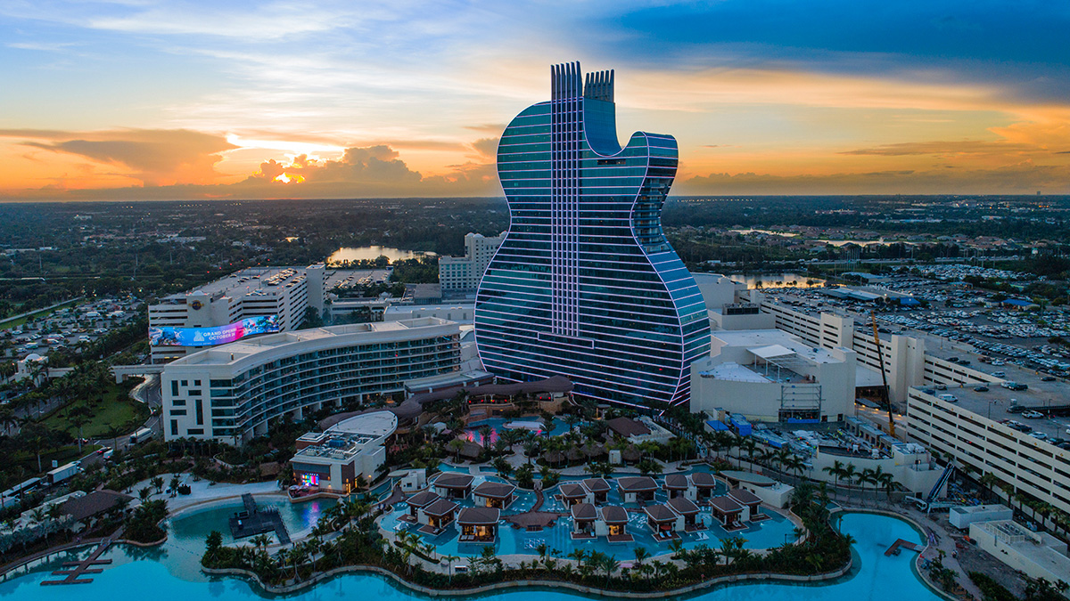 Aerial view of the Hard Rock guitar-shaped hotel and resort at sunset