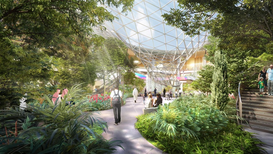 Rendering of nature-filled, airport hub with interior waterfall at the Hamad Airport