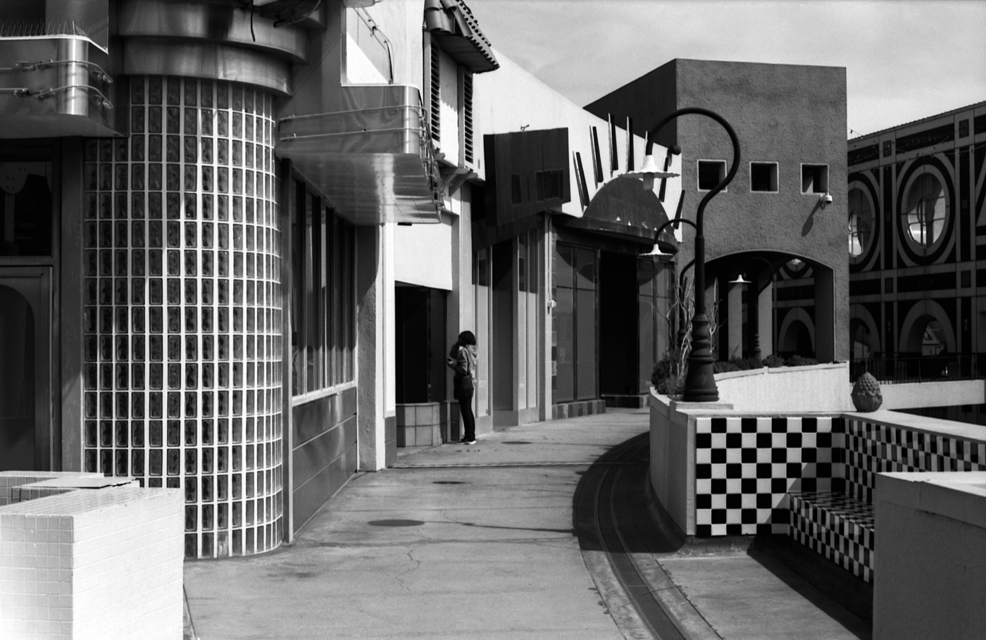 Black and white photo of Horton Plaza, a blocky shopping maill