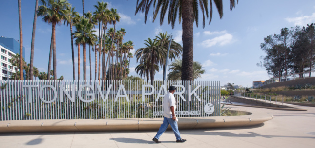 "A slat gate with the words ""Tongva Park"" on it"