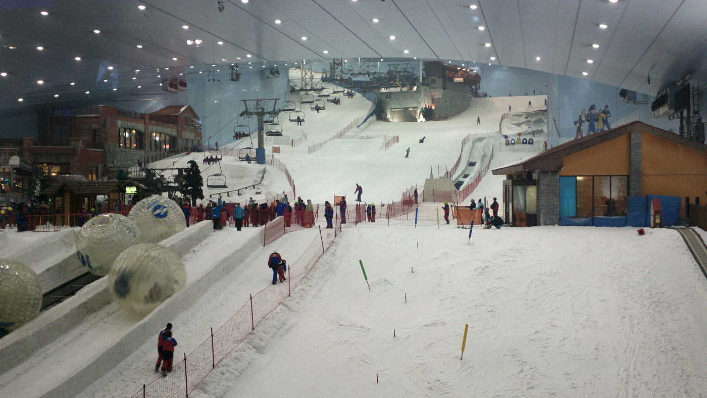 People skiing on an indoor ski slope