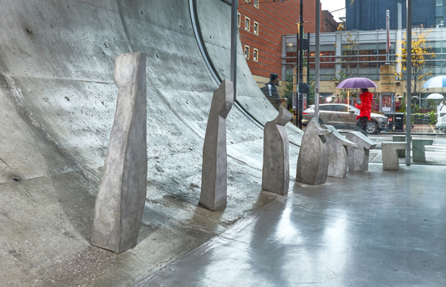 Stone sculpture scattered along a concrete ramp