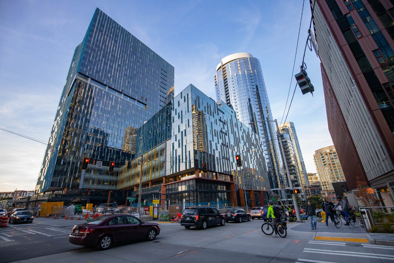 Exteriors street view of glass tower under construction in Seattle as part of the new Amazon campus