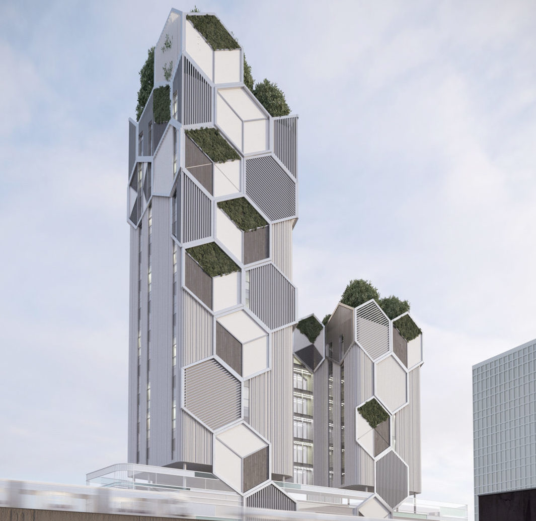 Image of green tower with hexagonal facade elements