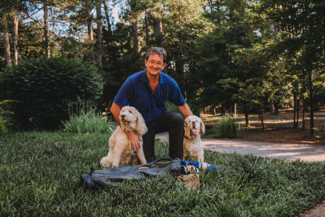 Image of man with two dogs