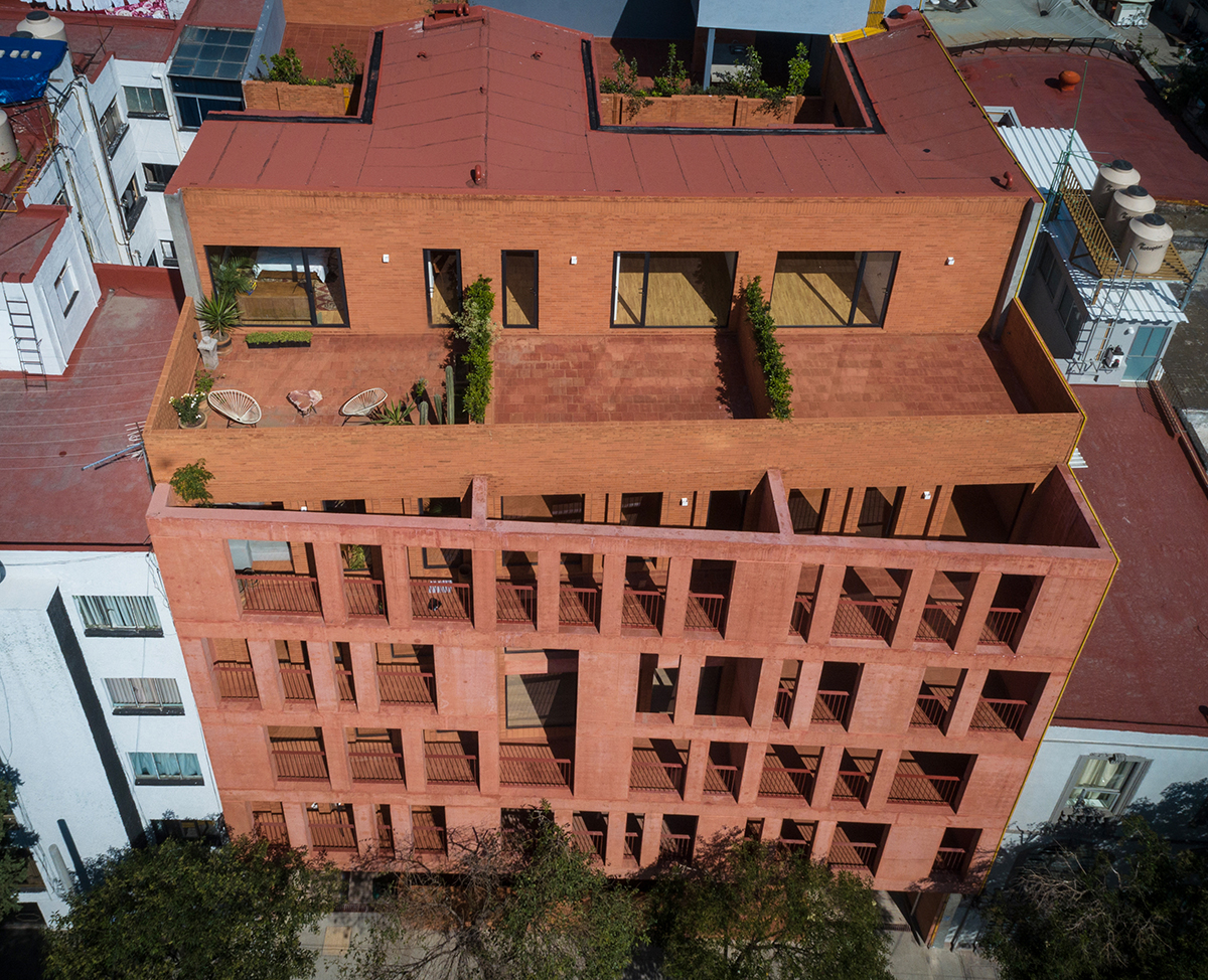 Exterior image of red brick building from above