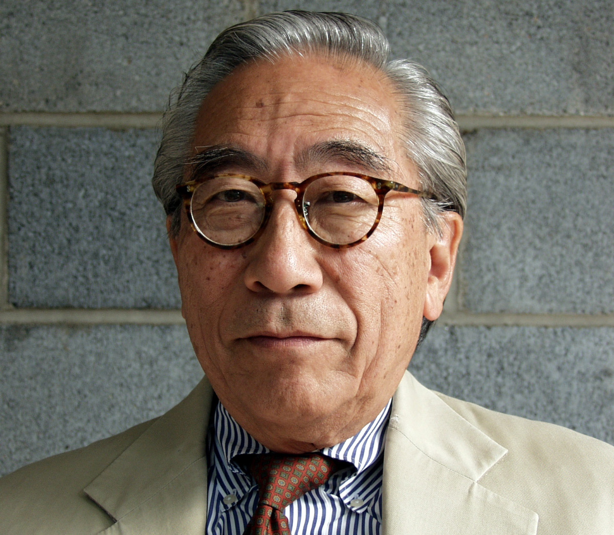 Headshot of an elderly Asian man