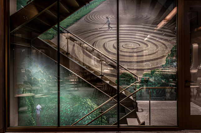 Image of staircase against mural inside of a Starbucks