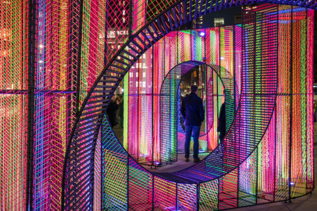 Installation view of the Flatiron Holiday Design pavilion, a swirling string structure
