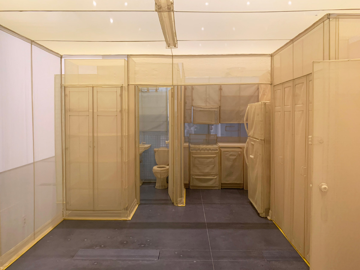 Interior photo of an apartment unit made from yellow fabric by Do Ho Suh