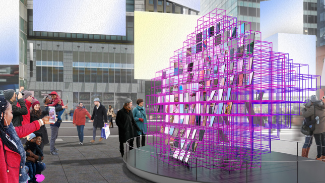 A side view of a pink steel-frame cubic sculpture with mirrors in Times Square