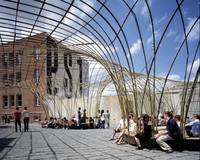 Inside the MoMA PS1 courtyard beneath a bamboo canopy