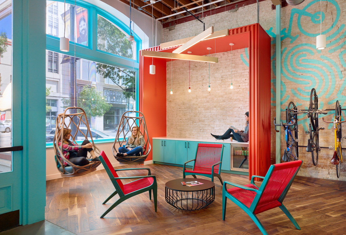 Interior of a Spreetail office, showing colorful metal accents