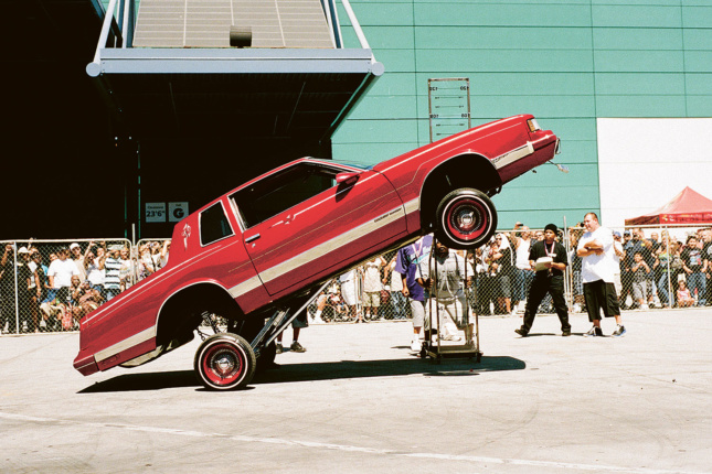 A red lowrider bouncing