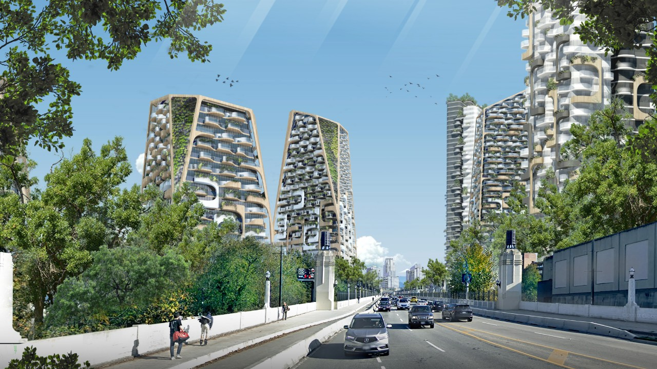 A rendering shows a view of a cluster of towers from a highway in vancouver